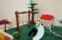 LEGO Park (kdweezer) Tags: lego park playground outdoors outside trees structure shelter huge large baseplate picnic table red roof flowers floral arrangement pot slide teeter totter chains swings swingset play outdoor barrel stairs fence pavilion lantern lights leaves leafy toys building