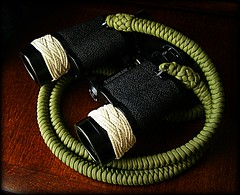 Paracord strap attached to my binoculars (Stormdrane) Tags: camera camping coastguard green sports wall army football moss fishing sailing glow baseball hiking stadium snake military navy tie knot racing binoculars backpacking strap boating marines edc birdwatching scouting gaucho everydaycarry soccor lanyard binocs paracord sinnet splitring twostrand 550cord stormdrane