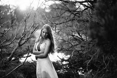 watching the butterflies die (Mary.Parker) Tags: trees winter portrait blackandwhite woman cold film girl feminine branches grain naturallight ilfordhp5 blonde brambles emotive whitedress femaleportrait filmphotography maryparkerphotography