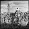 looking for new challenges (Radoslaw Pujan) Tags: looking far lighthouse topless swimsuit bikini hat woman elegance fishing film analog hasselblad 6x6 bw formentera ibiza