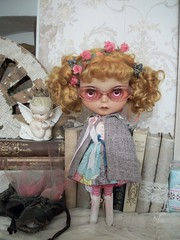 Not everything is seen thru rose colored glasses.... (simplychictiques) Tags: blythe ooakcustomblythedoll cinnamongirlcustom mohairreroot blythewithtanskin sunshine naturallighting happy mohairrerootbykate pigtails blythewearingglasses dressandcapebyalonso pinkglasses antiques books vintageitems liberty