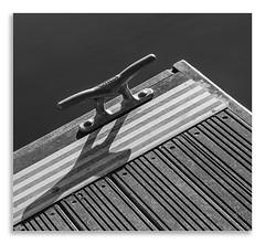 Idle Cleat (Martyn.A.Smith LRPS) Tags: outdoors waterfeature metal wood planks cleat shadows monochrome stripes fujifilm xti stratfordonavon warwickshire englanduk