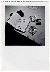 Still Life (Fremdwortlexikon) Tags: book glasses table blackandwhite cigarettes stilllife stillleben tisch buch schwarzweis brillen zigaretten aschenbecher ashtray zündhölzer streichhölzer matches tischdecke foundphoto monochrome bw