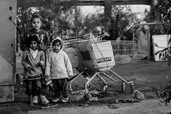 ....part of memories (Georgina ♡) Tags: monochrome blackandwhite athens greece candid portrait children shoppingcarts barefoot garbage poverty bridge