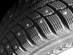 goodbye winter(tyres) (Ben McLeod) Tags: bw car closeup tire 50mmf14af wintertire studdedtire
