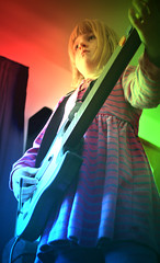 Guitar Hero (Glenn Loos-Austin) Tags: favorite playing girl kid child top20childportrait serious guitar ivy potd coloredlights guitarhero poisonivy ivyleague christmaspresent photooftheday interestingness416 interestingness389 i500