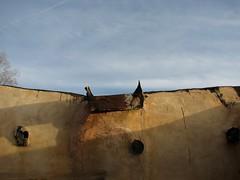 stucco, bondo & tar (Dill Pixels (THE ORIGINAL)) Tags: adobe wall crack stucco tar roof viga wood gutter repair homemade old taos newmexico mountain town remote hispanic pueblo