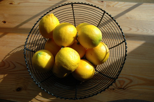 Lemons in a Black Wire Bowl