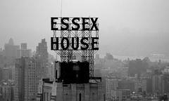 Essex House (Thomas Hawk) Tags: nyc newyorkcity blackandwhite bw usa house newyork sign buildings grey blackwhite neon day unitedstates manhattan unitedstatesofamerica foggy essex essexhouse