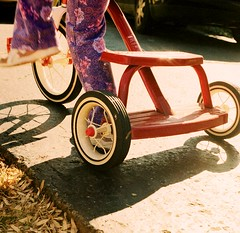Trike (WadeB) Tags: tricycle radioflyer red purple feet shoes wheels blur motion child shadow spokes yashicamat124g tlr mediumformat 120 kodak400uc yashica film wow lowsun 1025fav topv111