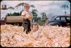 Photo from the 60s of kids sitting in corn husks