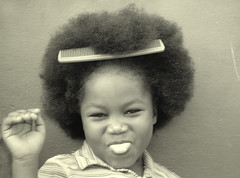 Little Marlene's Fro (JakeBrewer) Tags: 2004 tongue hair children blackwhite women little afro smiles adorable orphans jamaica christiana portfolio playful comb feisty 25faves mywinners 5for2 raziks20 jakesfavoritemoments