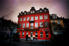 gloom is in the heart (maxivida) Tags: winter red cold dark gloomy 500v50f bleak konstanz maxivida constance gloomyheart hotelhirschen