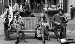Abbey Churchyard, Bath, England (Mark Hulbert) Tags: street people blackandwhite bw film delete2 noiretblanc trix streetphotography save3 delete3 save8 delete save save2 save9 save4 violin icecream save5 save10 save6 savedbythedeltemeuncensoredgroup facebook bathengland abbeychurchyard nikonfg20 blackwhitephotos autaut flickriver