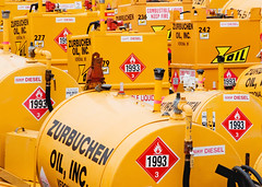 Fuel Depot (Todd Klassy) Tags: signs color colour industry yellow horizontal wisconsin danger warning wagon outdoors fire dangerous colorful industrial tank graphic bright many transport group rental dot storage hose gas safety diamond container 1993 several verona signage oil depot labels trailer gasoline fullframe coloryellow protection wi trailers fuel hazmat tanks placards flammable class3 stockphoto amounts vividcolors regulations stockphotography compliant osha descriptive colorimage combustible smallbusiness fueloil zurbuchen dieselfuel veronawisconsin hazmatplacards wisconsinphotographer hazardousmaterialsplacards wisconsinphotographers safetysignage toddklassy wisconsinbusiness wisconsindocumentaryphotographer hazardclass zurbuchenoil fuelcarts