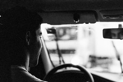 Rearview Mirror (Tércio Campelo) Tags: street light blackandwhite film car rain mirror nikon trix streetphotography kodaktrix rearview f80 nikonf80 streetphotographer filmisnotdead kodaktrix400800 believeinfilm