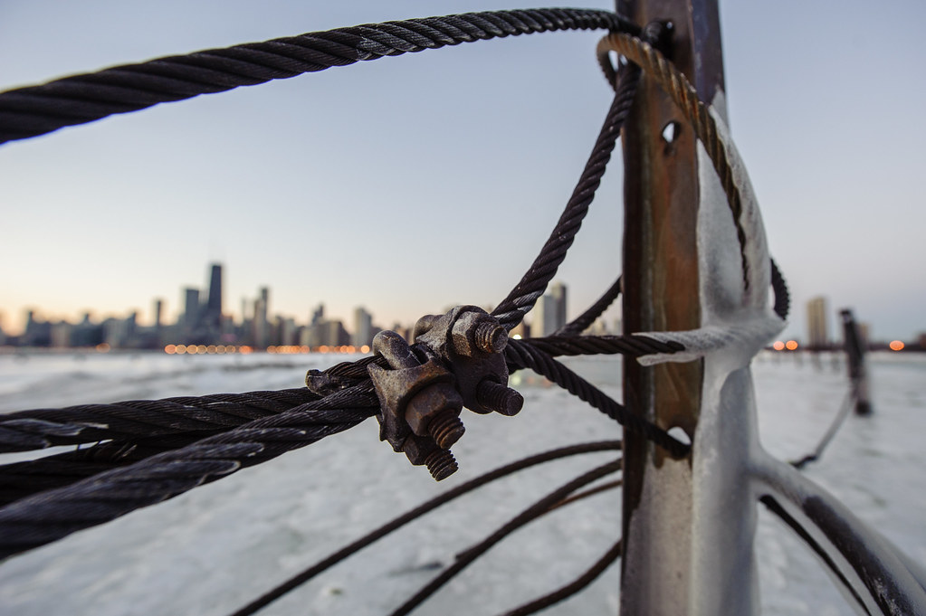 The Chicago skyline through some thick metal wire near North Ave. Beach.