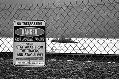 Stay off the tracks! (niKonJunKy22) Tags: hff tracks transportation trains train water river columbia washington travel driving sign danger dangerous fence protection island nikon d700 bw 2485nikkor blackandwhite black ngc