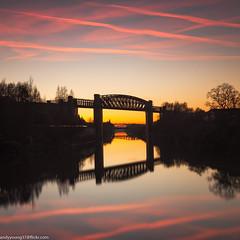 Latchford Locks  (1 of 1) (andyyoung37) Tags: latchfordlocks manchestershipcanal reflections uk warrington bridge cheshire oldrailwaybridge orangesky sunset