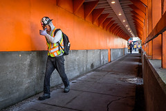 Freestyle hanky (johnjackson808) Tags: eastbroadway fujifilmxt1 kingsway vancouver construction nose orange people streetphotography worker
