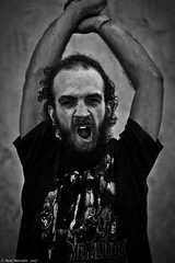Primal Scream. (Neil. Moralee) Tags: madeieaneilmoralee musician busker music play man scream beard primal primative street candid wild animalistic band violent roar heavy metal singer black white bw blackandwhite mono monochrome face close detail shadow tshirt radical neil moralee nikon d7100 18300mm zoom performance perform rock