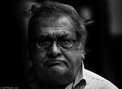 Grumpy. (Neil. Moralee) Tags: sulky grupmy temper bad badtempered old mature man face portrait candid black white bw mono monochrome blackandwhite neil moralee nikon d7100 funchal madeira shadow wrinkles glasses men street frown dark frustrated age