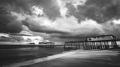 Frailty [EXPLORED] (Travis Rhoads) Tags: northcarolina outerbanks obx theouterbanks capehatterasnationalseashore friscopier 2016 blackandwhite copyright2016 sonya7r2ilce7rm2 zeissbatis18mmf28 travisrhoadsphotography monochrome sony leefoundationkit lee3stopnd leefilters landscapephotography fishingpier coastal