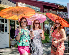 Wine, Shades and Parasols (Tex Texin) Tags: street pink ladies orange girl sunglasses female umbrella colorful wine fair stranger shades parasol trio losaltos wineandcrafts