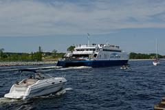 Lake Express & Her Entourage (joeldinda) Tags: city sky cloud tree june ferry boat nikon ship michigan lakemichigan greatlakes channel v2 muskegon 2015 pleasureboat lakeexpress 2890 1v2 nikon1v2