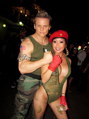 NOLA Halloween: Street Fighter Couple, Guile and Cammy (shaire productions) Tags: nola neworleans image picture photo photograph city urban night evening event halloween party outdoor imagery costume revelry girl beauty hot asian model cammy military style videogamecharacters guile love happy fashion videogame 80s 90s capcom street people fun celebration