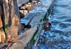 Wood grain and swirling water, breakwater, Reculver (Aliy) Tags: breakwater groyne reculver kent wood gnarly woodgrain sea swirls swirly swirling oldwood oldtimber timber pebbles