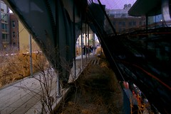 Peeking at High Line Strollers (from stairway to w28 st.) (sjnnyny) Tags: canopy highline visitny constructioncovering ultragentrification sculptural stretchfabricstructure people pathway sonya6000 mirrorless zahahadid nycparks highconceptlandscape stevenj sjnnyny sigma sigma19mmf28dnemount apartmentbuildings scenic depthoffield winternyc urbanoasis lofts repurpossedindustrial