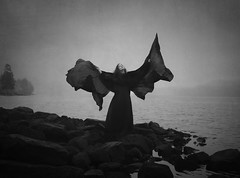 It Turns The Bright Day Black (Maren Klemp) Tags: fineartphotography fineartphotographer blackandwhite monochrome darkart darkartphotography wings lake ocean water nature outdoors woman selfportrait portrait surreal conceptual dreamy painterly evocative ethereal