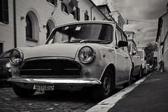tiny plates on tiny cars land (333 Half Evil) Tags: nikon d5200 dslr nikkor 18105mm zoom rome city street tiny small car vehicle bw monochrome travel