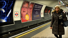 `1903 (roll the dice) Tags: london platform passengers tube underground tfl stpauls station people natural surreal sad mad funny streetphotography poster advertising face mouth implants amazing magic lights colour uk art classic urban england unaware unknown candid portrait stranger canon roundel tourism busy track rail tickets fashion shops shopping life quiz changes oldandnew laugh londonist tunnel paper city ec4