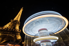 Spinning in Place (foteaux) Tags: longexposure travel paris france timelapse eiffeltower carousel lighttrails