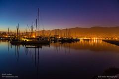 Harbor City Lights (Bill Heller) Tags: ocean california city mountain water santabarbara night sailboat evening harbor boat twilight pacificocean citylights californiacoast santabarbaraharbor