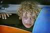 Richard... (carf) Tags: child children boy atrisk childrenatrisk angel curlyhair blonde eyes sunburn cream curlylocks richard surfboards content happy