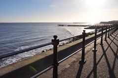 Winter light and shadow (Kirkleyjohn) Tags: beach light shoreline shadow fence sea seaside seashore seascape seafront promenade lowestoft