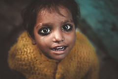 Black Eyes. Varanasi, India (Marji Lang Photography) Tags: banaras benares canoneos5dmarkii ef247028l ganges gowdolia india indian indianbaby indianchild indianpeople indians kashi marjilang travelphotography uttarpradesh varanasi baby bigeyed bigeyes child childhood documentary documentaryportrait emotion emotional eyecontact eyed eyes gaze ghats girlchild holycity look lookatme looking people photojournalism portrait portraiture poverty save soul soulful soulfuleyes soulfulportrait stare streetportrait struggle travel young youth blackeyes flickrportrait flickrfriday beautifuleyes