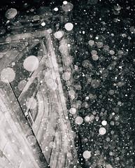 snowing like fury (almostsummersky) Tags: monochromatic arch building winter snowstorm maine snow columns urban upward portland sky fortis architecture night bokeh snowfall winterstorm blackwhite unitedstates us