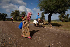 Mother walks a few miles for water from a well