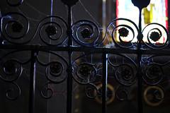 Sacred Lights (gripspix (OFF)) Tags: 20161007 konstanz constance vacation urlaub kirche church münster detail innenraum indoor licht light colorful bunt buntglasfenster stainedwindows spiritual spirituell sacred gate gitter steellattice türe forgediron schmiedeeisen cobwebs spinnweben