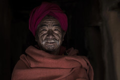 Rising sun - L'alba di un nuovo giorno (silvia pasqual) Tags: asia asian nepal nepali people portrait man old elderly rising sun shining eyes light darkness colors color colorful red human humanity traditional face beautiful smile happy happiness canon photo photography travel travelling travelers souls world soul person portraiture culture documentary reportage mustang morning