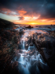 Winter's Welcome (Timothy Gilbert) Tags: panasonic beach wideangle sunrise coast atlantic ultrawide nikcollection gx8 portwrinkle olympus918mmf4056 cornwall boulders rocks