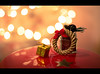 Merry Christmas! (the girl with the blue scarf) Tags: merry christmas winter holiday december gifts bokeh ribbon stars candke tree reflection happiness colorful shiny lights red yellow thegirlwiththebluescarf theaanca