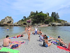 Both sides of the story (Couldn't Call It Unexpected) Tags: pebbles isthmus dancer playa sicily taormina italy island