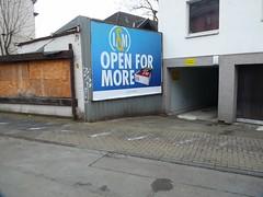 open for more (QQ Vespa) Tags: plakatwand plakat köln nippes lm openformore werbung garage kölle garagentor