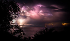 Costa Rica Lightning (JarrodLopiccolo) Tags: costa rica lightning costarica night sky clouds landscape ocean sea palmtree red purple blue outdoor water 2014 manzanillo santateresa