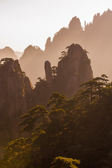 Sunrise near the Lion Peak (laskaproject) Tags: china light shadow sun mountain tree beautiful yellow pine sunrise landscape scenery rocks view atmosphere layers rays distance depth huangshan